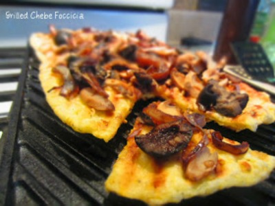 Grilled Chebe Focaccia with Black Olives Mushrooms and Balsamic Onions